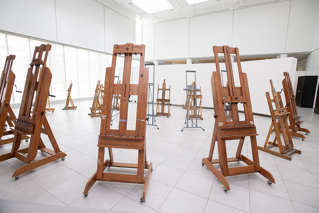 Easels are placed in University Gallery.