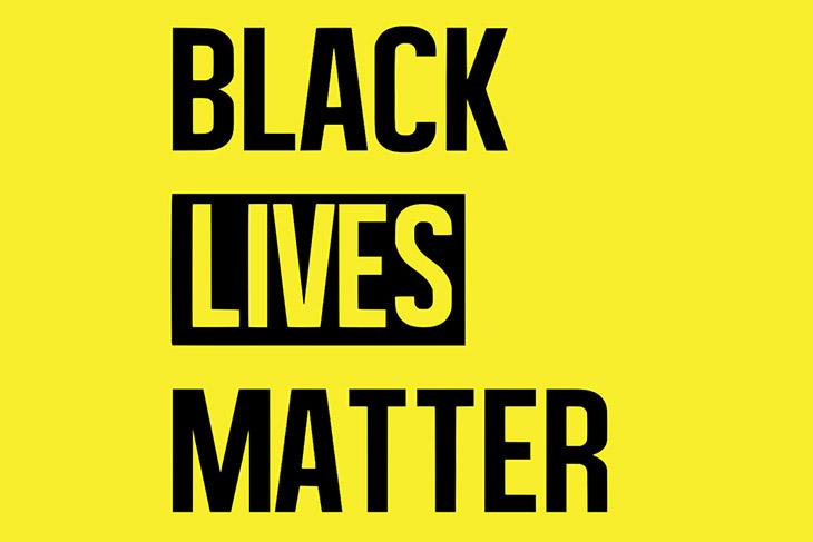 Black Lives Matter logo on yellow background.