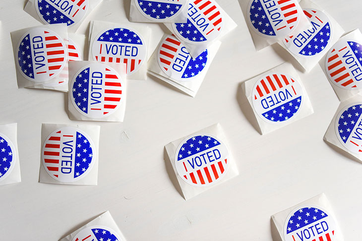 """several patriotic """"I Voted"""" stickers."""