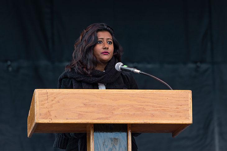 woman speaking at a podium.
