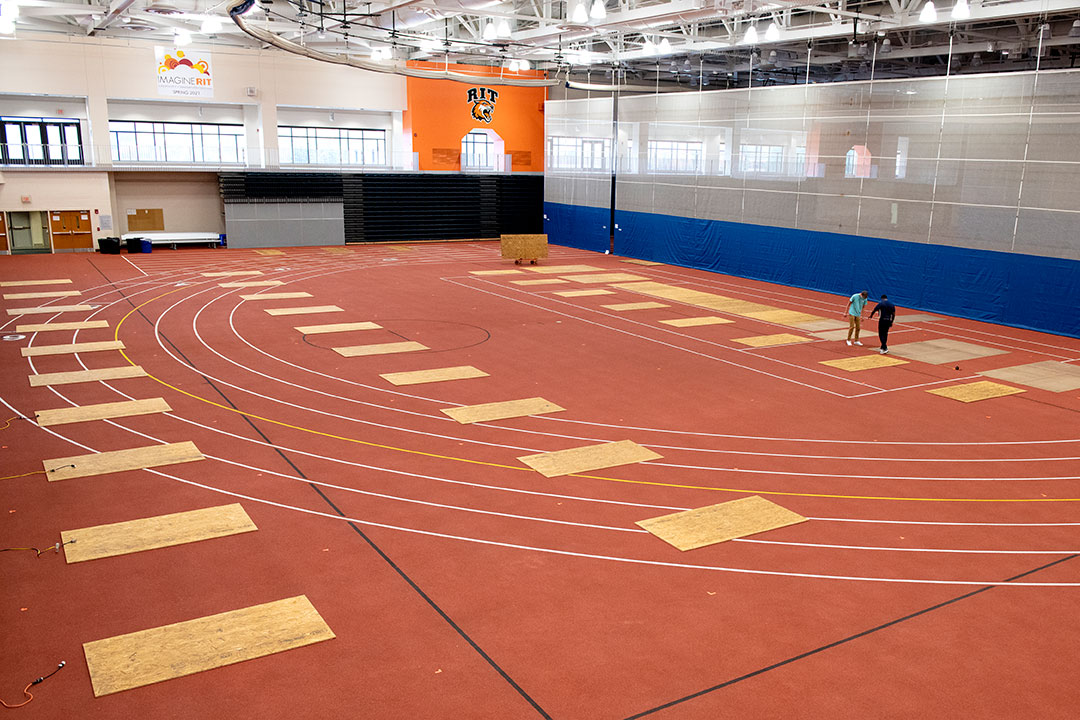 field house with several mats spaced out on the floor.