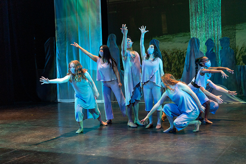 seven dancers performing on a stage.