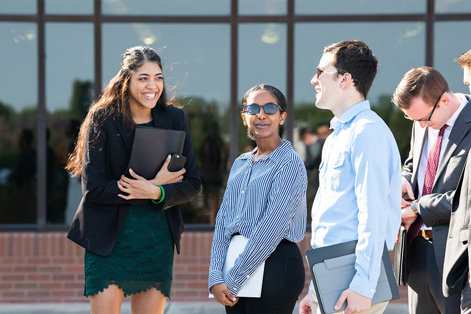 Students outside waiting for career fair on RIT campus