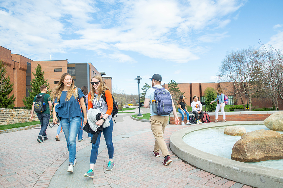 Students walking through RIT campus.