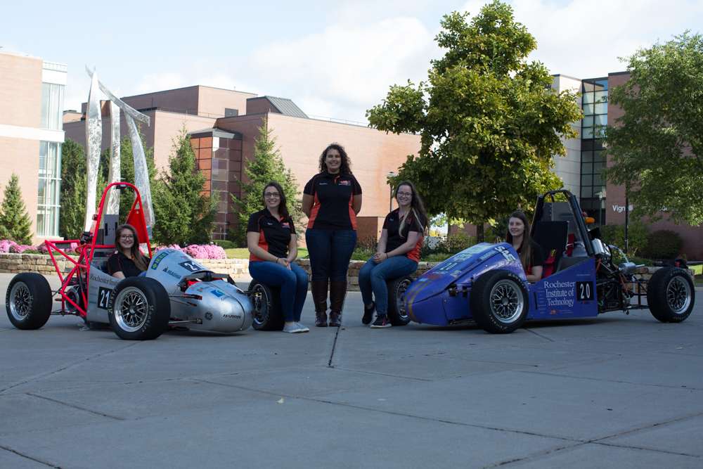 Hot Wheelz students with their vehicles