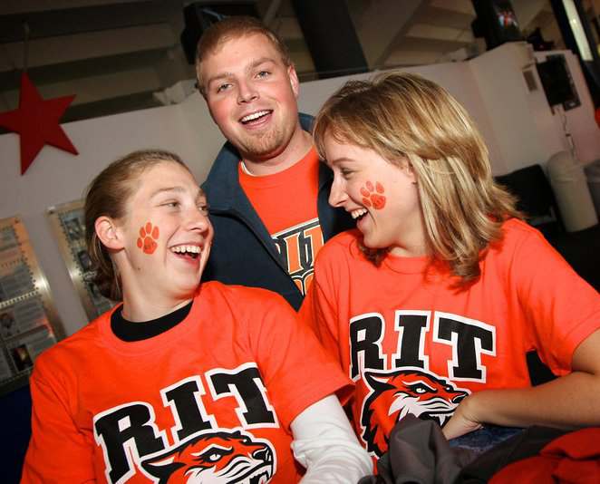 Three people wearing RIT tiger shirts