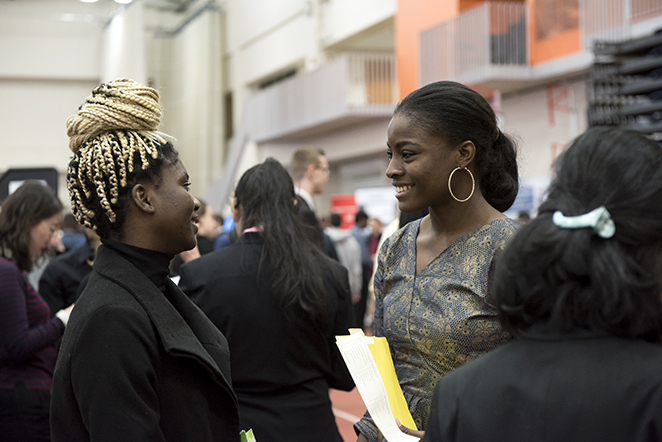 people at a career fair in Gordon field house