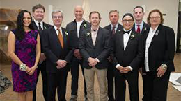 Distinguished alumni awardees standing shoulder to shoulder
