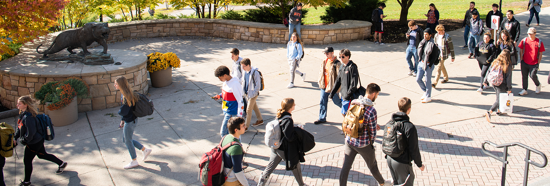 students walking down quarter mile