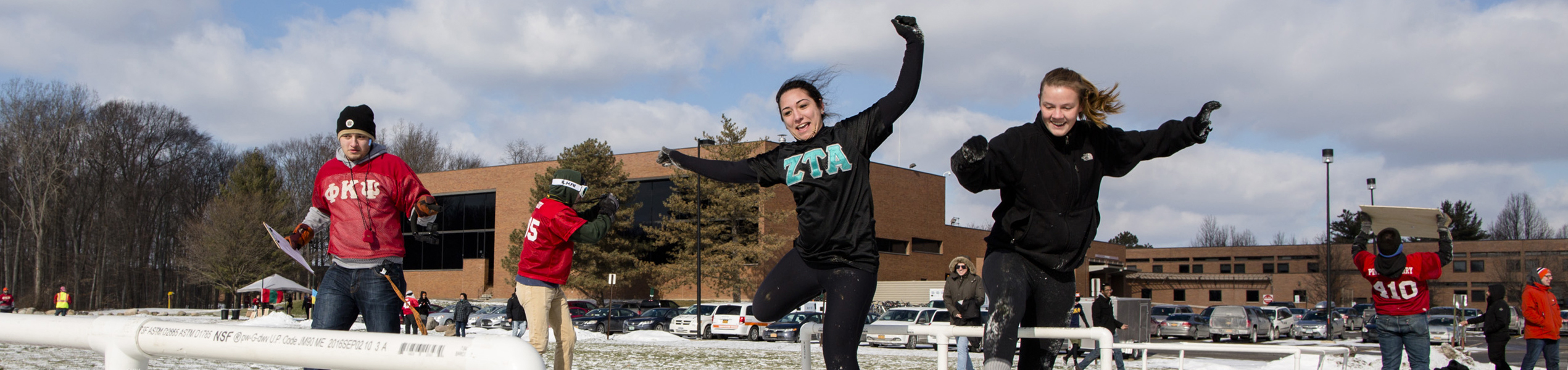 students doing hurtles at RIT Freezefest in the snow