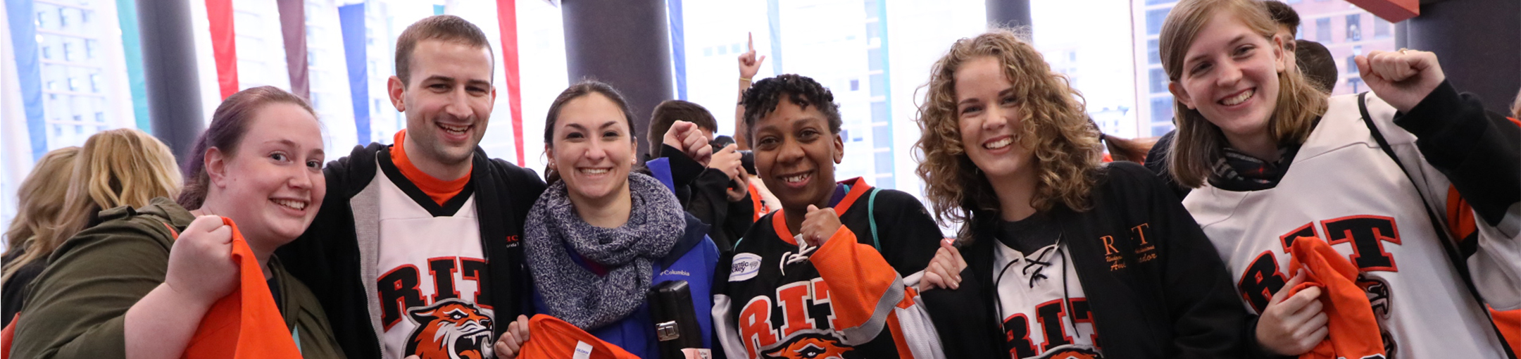 Students wearing RIT shirts and other gear