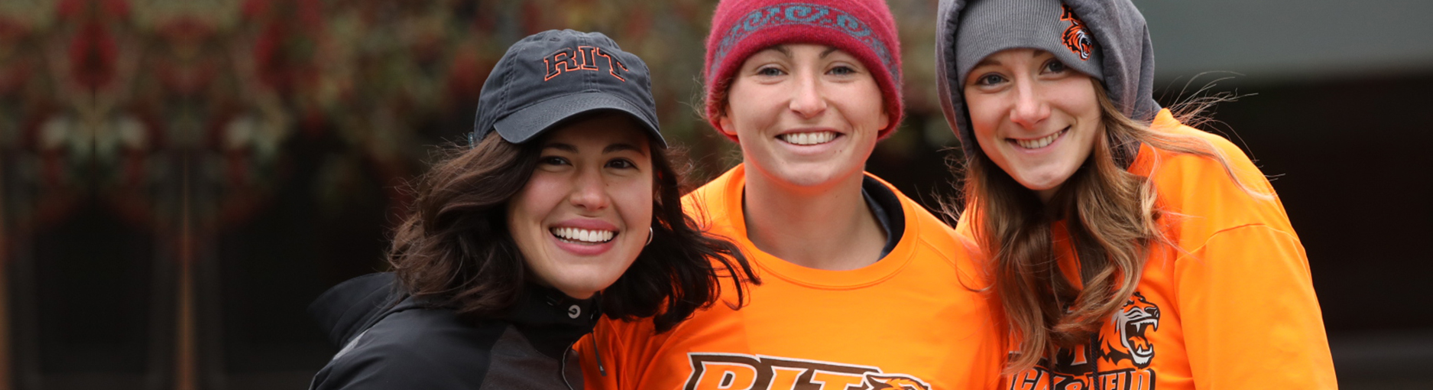 three female RIT students Smiling