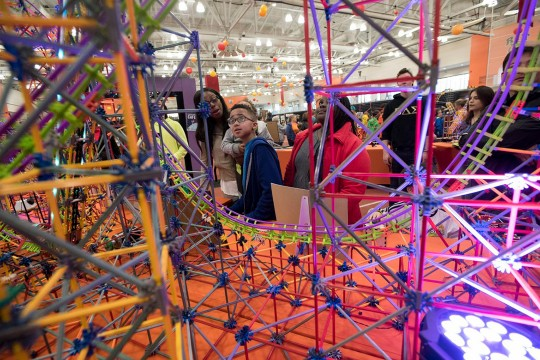Student looks at rollercoaster made from K'Nex.