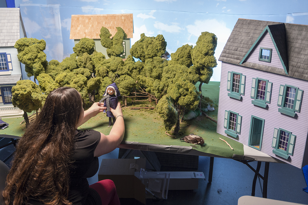 A student works in a stop motion studio