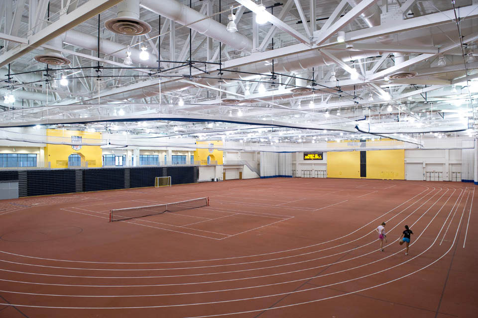 Empty Gordon Field House with a tennis court net up