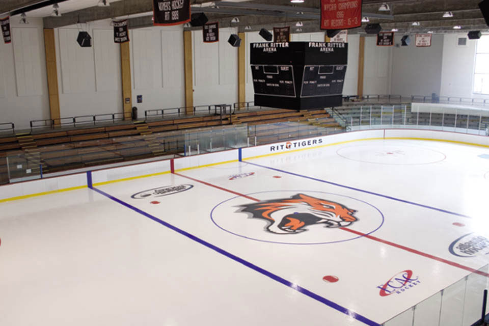 Empty Frank Ritter ice arena with fresh ice and the RIT tiger logo in the center