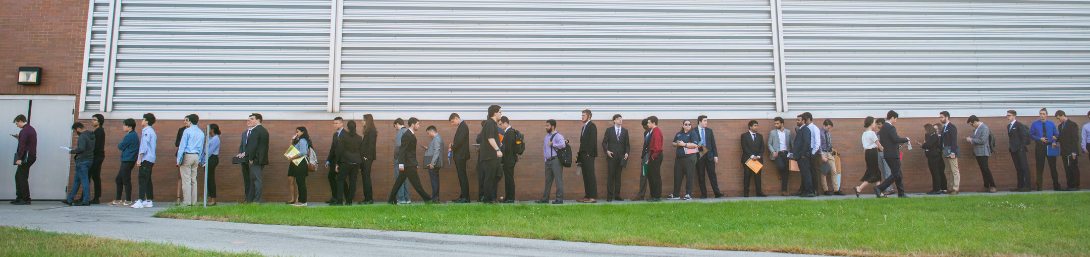 A line of students waiting to enter the Gordon Field House for a career fair.