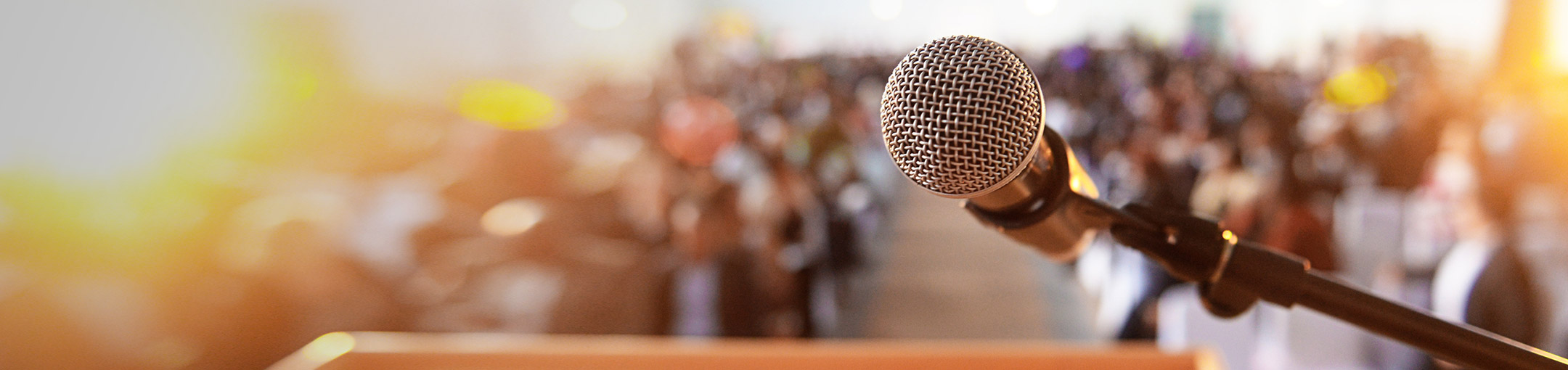 photo of a microphone in front of a crowd