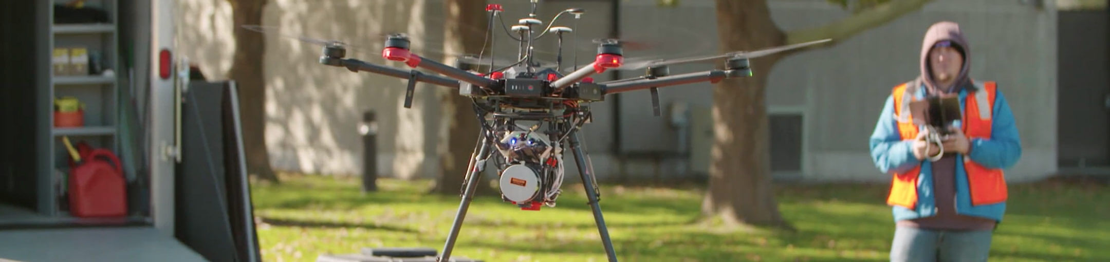 A drone pilot flying a drone with sensors on it