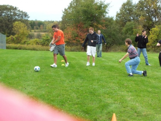 Dr. Richmond and other students playing soccer.