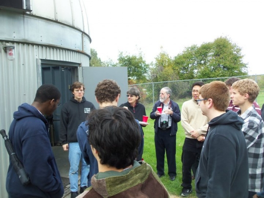 Dr Richmond talking to students outside of the observatory