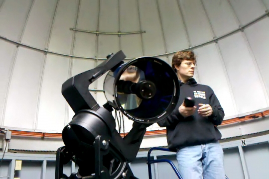 Dr Richmond talking to students inside the observatory