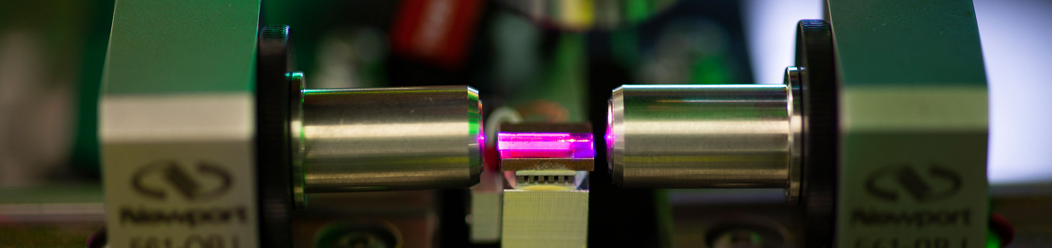 an electronic device emitting a pink light