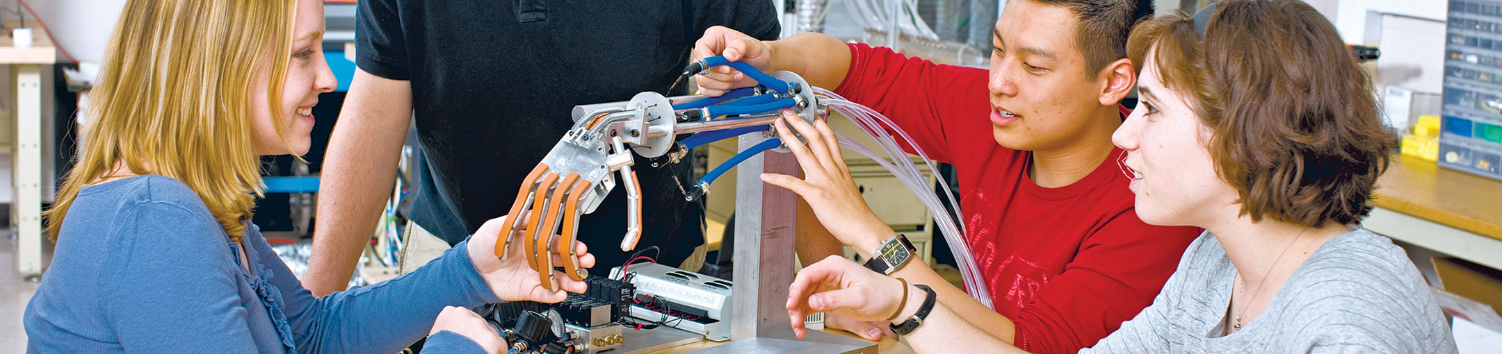 Students using a robotic hand