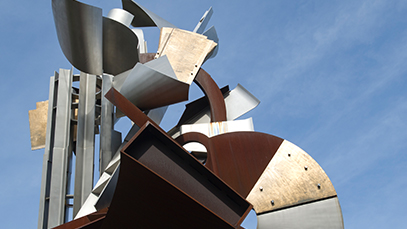 An RIT sculpture with the sky in the background