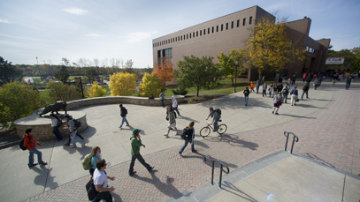 Students walking across campus on a sunny day