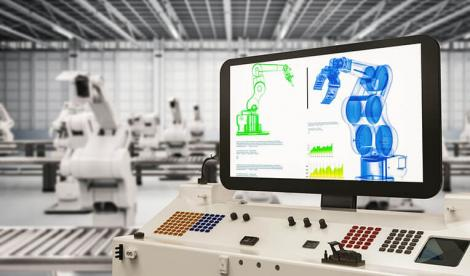 monitor showing the schematic of the robotic arms on the assembly line behind it
