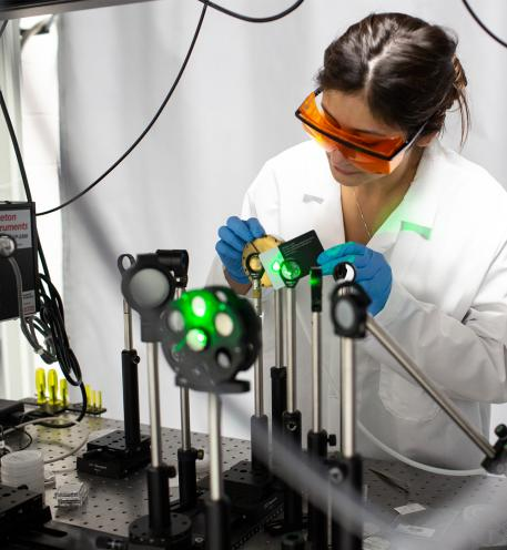Female researcher working with lasers