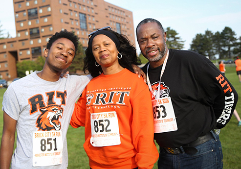 African American family wearing RIT clothing