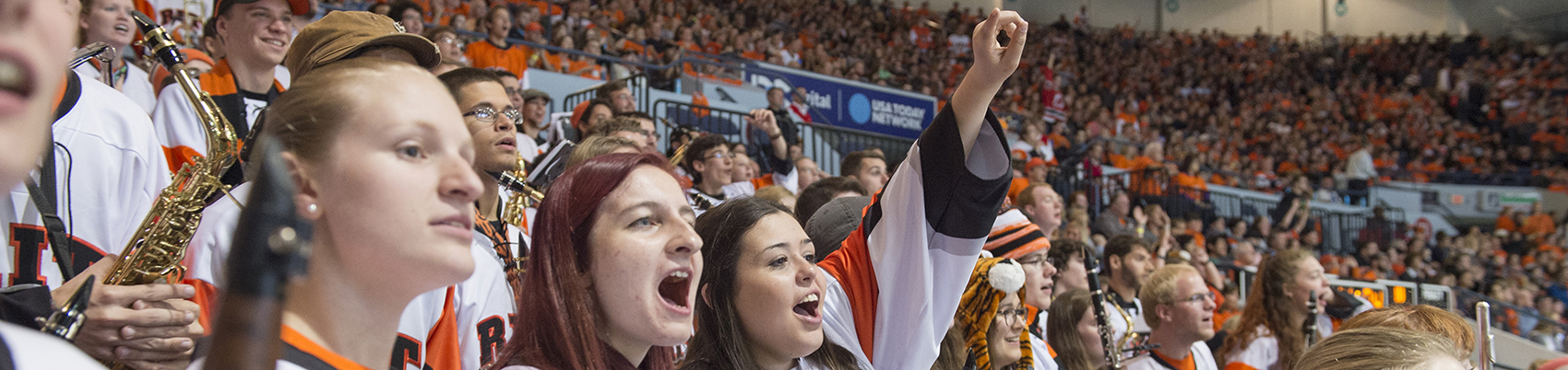 Students at RIT hockey game cheering