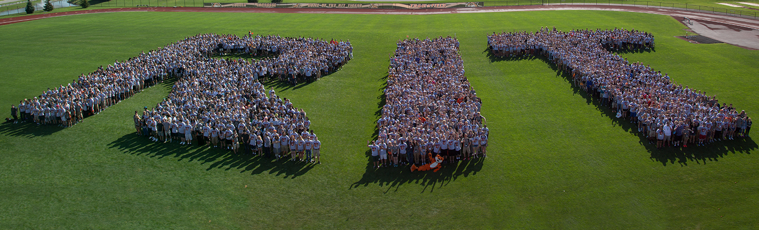 RIT made out of people standing in campus