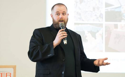 man speaking at an event at R I T
