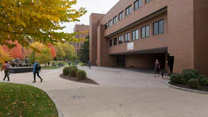 Students walking across campus on a fall day
