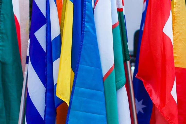 Country flags close together slack on poles