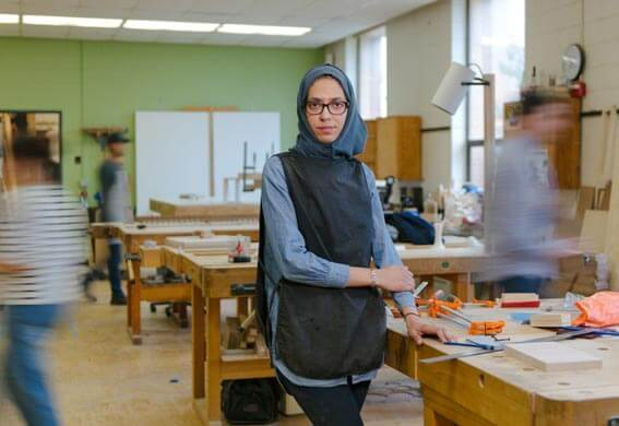 Moving background with a woman in a woodworking shop