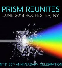 """A photo of a prism splitting light into a spectrum of colors on a black background under text that reads """"PRISM REUNITES: June 2018, Rochester, NY"""""""