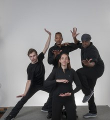 The four performers of Sunshine 2.0 strike a dramatic pose against a plain gray background.