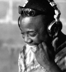 Kojo Amissah, wearing a set of headphones, performs.