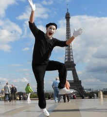 JJ Jones, a mime, leaps into the air in front of the Eiffel Tower in Paris, France.