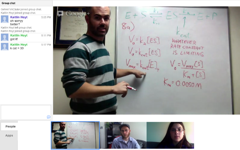 Tutor wrote the formula to a problem on a white board and is showing it to a student over Google plus hangout.