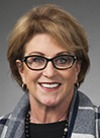 Headshot of Barbara  Montan, short brown hair, glasses