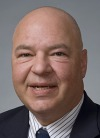 Headshot of Steven  Weintraub, bald man, dark suit and tie