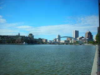 Photo of Rochester NY skyline looking over water.