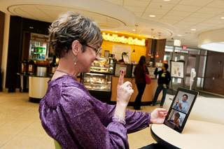 Woman communicating via video using a tablet
