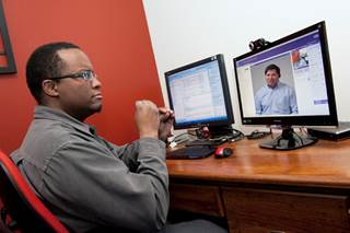Man communicating via video on a computer