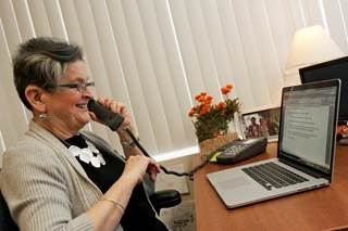 Woman using a web-captioned telephone